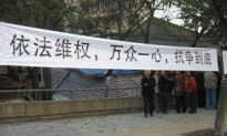 Laid-Off Workers Protest Violent Eviction